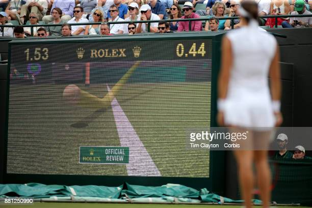 Caroline Garcia of France watches a video review after challenging a call during her match against Johanna Konta of Great Britain in the Ladies'...