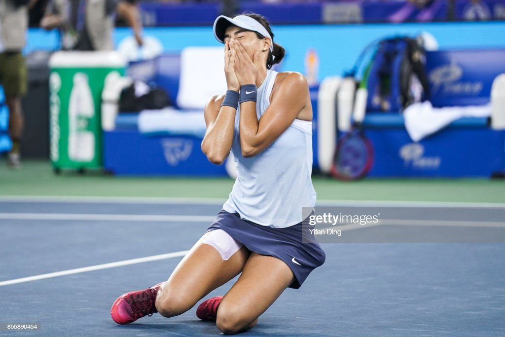 Caroline Garcia reacts after winning the ladies singles final between Ashleigh Barty of Australia and Caroline Garcia of France during Day 7of 2017 Dongfeng Motor Wuhan Open at Optics Valley International Tennis Center on September 30, 2017 in Wuhan, China.