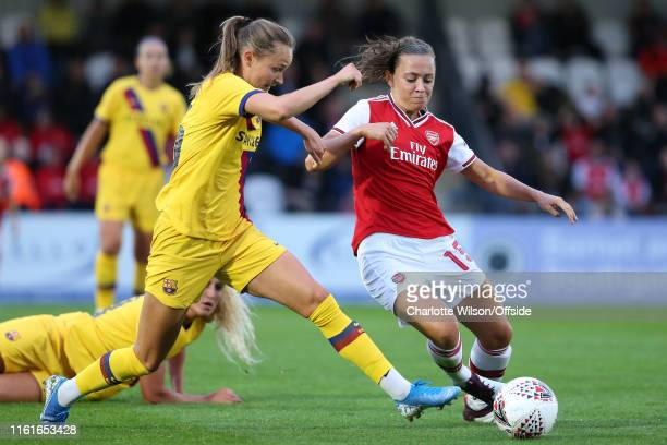 Caroline Graham Hansen of Barcelona and Katie McCabe of Arsenal during the preseason friendly match between Arsenal and Barcelona Women at Meadow...