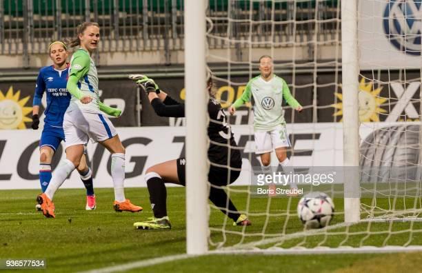 Caroline Graham Hansen of VfL Wolfsburg scores her team's second goal against goalkeeper Barbora Votikova of Slavia Praha during the UEFA Women's...