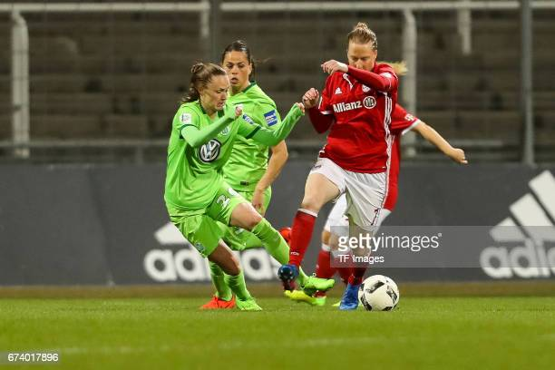 Caroline Graham Hansen of Wolfsburg and Melanie Behringer of Munich battle for the ball during the Women's DFB Cup Quarter Final match between FC...