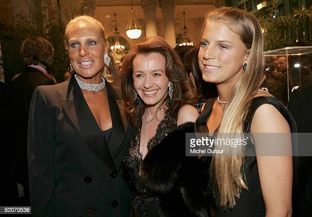 Caroline GruosiScheufele poses with Miss Saperstein and daughter at the Chopard Party at the Intercontinental Hotel as part of Paris Fashion Week...