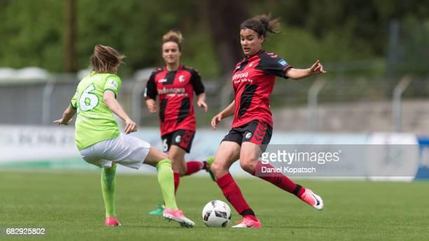 Caroline Hansen of Wolfsburg is challenged by Cinzia Zehnder of Freiburg during the Women's Bundesliga match between SC Freiburg and VfL Wolfsburg at...