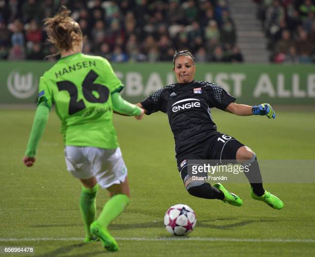 Caroline Hansen of Wolfsburg is challenged by Sarah Bouhaddi of Lyon during the UEFA Women's Champions League Quater Final first leg match between...