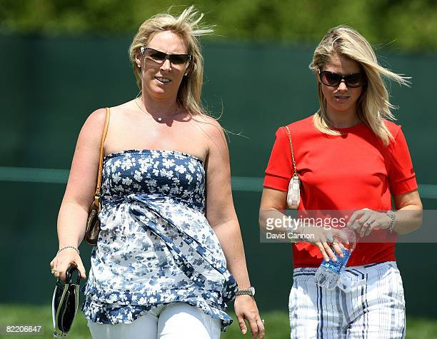 Caroline Harrington and Carminita Immelman walk together during round one of the 90th PGA Championship at Oakland Hills Country Club on August 7 2008...