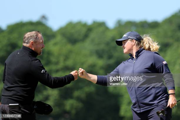 Caroline Hedwall of Sweden and Darren Fichardt of South Africa fist bump on the 18th green during the third round of The Scandinavian Mixed Hosted by...