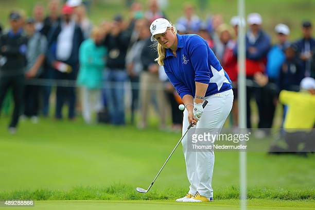 Caroline Hedwall of the European Team chips the ball at the first tee during the Sundays single matches in the 2015 Solheim Cup at St LeonRot Golf...
