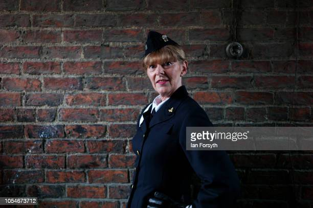 Caroline Higgs from Newtown wears US Navy uniform as she poses for a picture during the North Yorkshire Moors Railway 1940's Wartime Weekend event on...