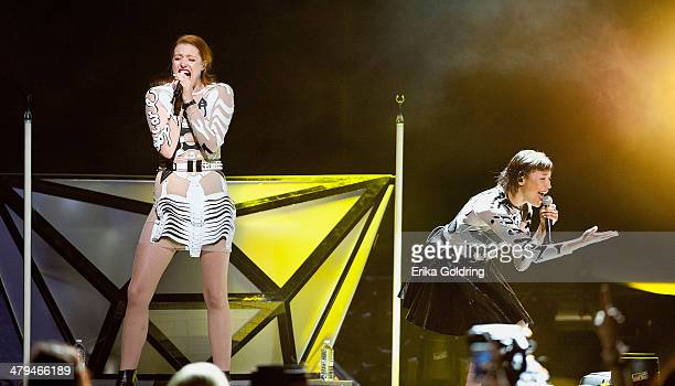 Caroline Hjelt and Aino Jawo of Icona Pop perform at Smoothie King Center on March 18, 2014 in New Orleans, Louisiana.