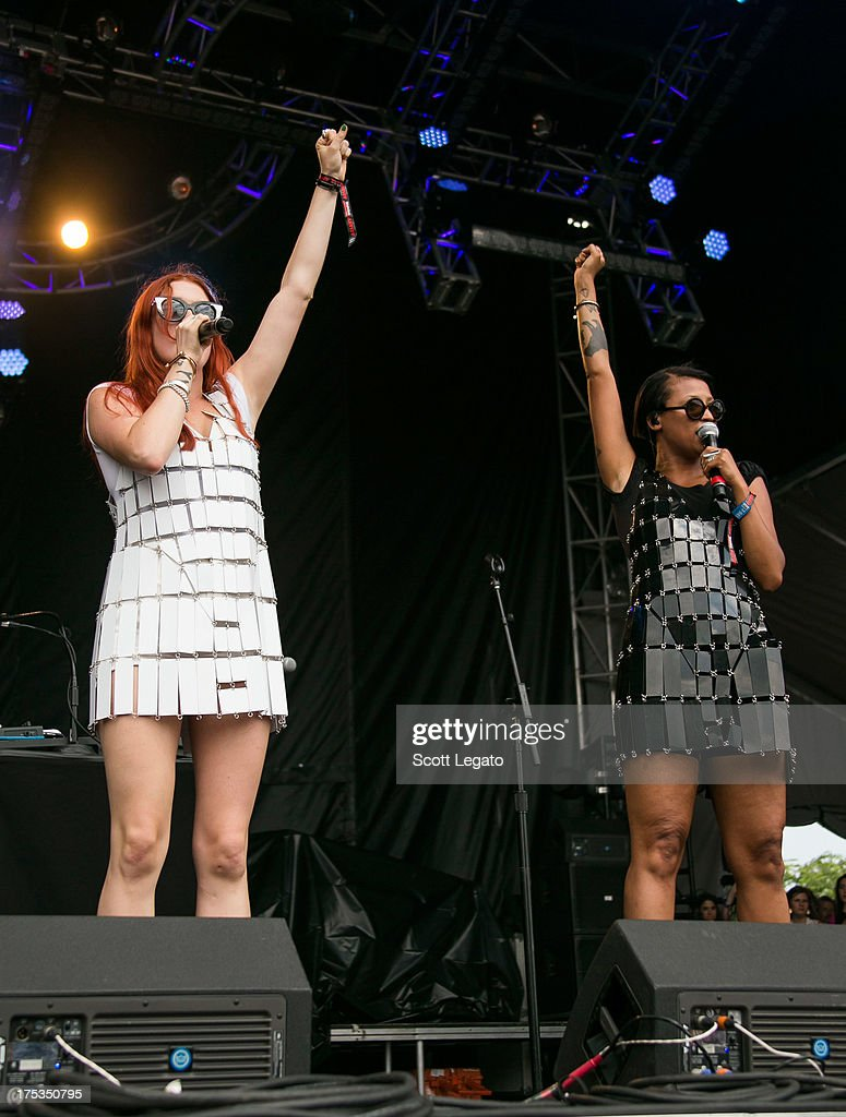 Caroline Hjelt (L) and Aino Jawo of Icona Pop perform during Lollapalooza 2013 at Grant Park on August 2, 2013 in Chicago, Illinois.