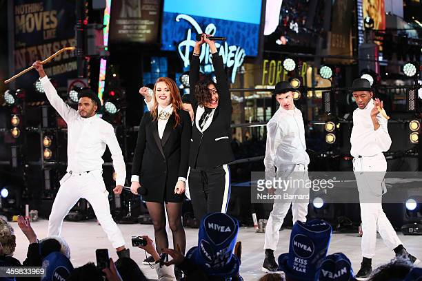 Caroline Hjelt and Aino Jawo of Icona Pop perform on stage ahead of midnight at The New Year's Eve 2014 Celebration in Times Square on December 31...