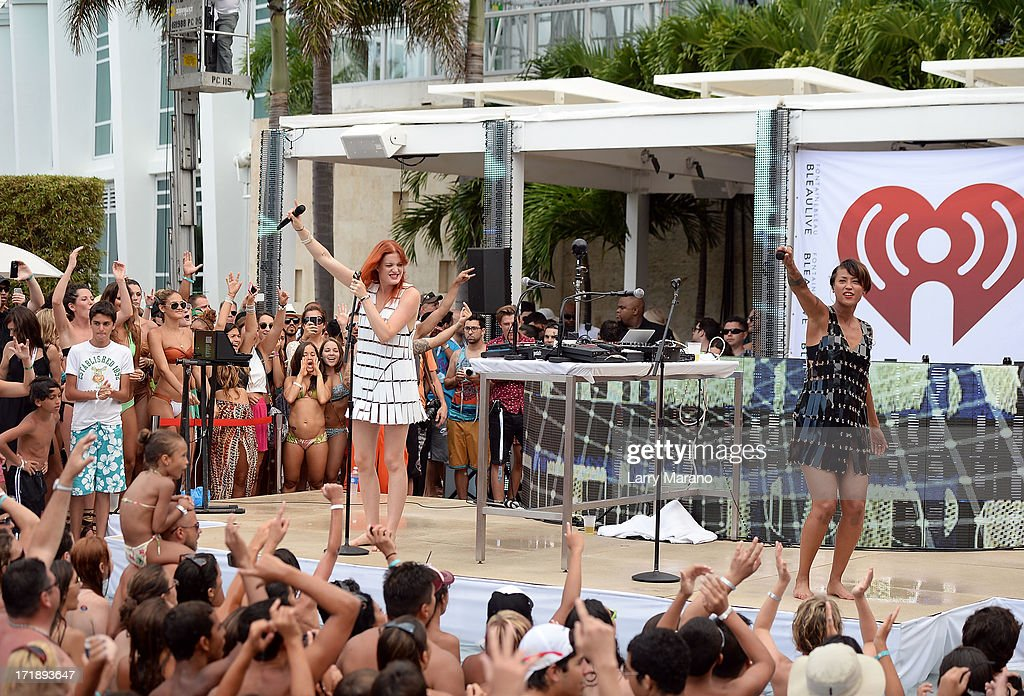 Caroline Hjelt and Aino Jawo of Icona Pop perform onstage at the iHeartRadio Ultimate Pool Party Presented by VISIT FLORIDA at Fontainebleau's BleauLive in Miami featuring live performances by Pitbull, Ke$ha, Afrojack, Icona Pop, Krewella and Jason Derulo on June 29, 2013 in Miami Beach, Florida.