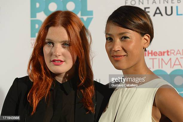 Caroline Hjelt and Aino Jawo of Icona Pop pose backstage at the iHeartRadio Ultimate Pool Party Presented by VISIT FLORIDA at Fontainebleau's...