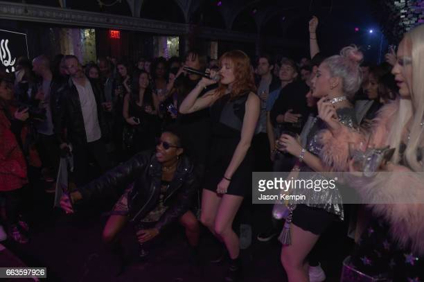 Caroline Hjelt of Icona Pop performs in the audience at the American Express Celebrates The New Platinum Card With Hamilton Takeover Experience on...
