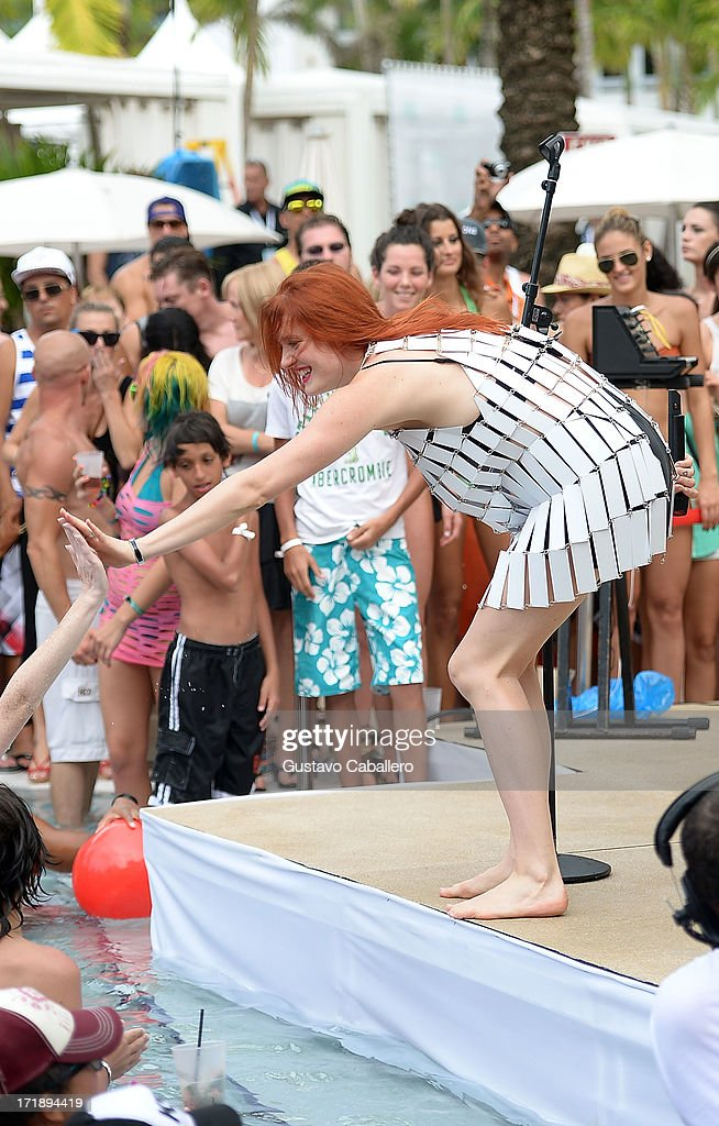 Caroline Hjelt of Icona Pop performs onstage at the iHeartRadio Ultimate Pool Party Presented by VISIT FLORIDA at Fontainebleau's BleauLive in Miami featuring live performances by Pitbull, Ke$ha, Afrojack, Icona Pop, Krewella and Jason Derulo on June 29, 2013 in Miami Beach, Florida.
