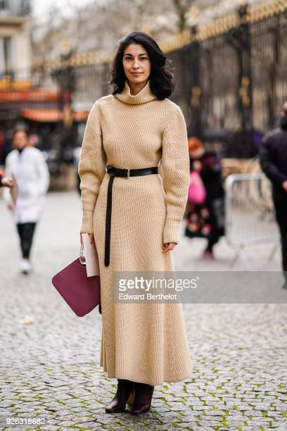 Caroline Issa a beige wool dress with a turtleneck a red bag and attends the Nina Ricci show as part of the Paris Fashion Week Womenswear Fall/Winter...
