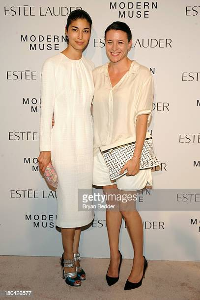 Caroline Issa and Garance Dore attend the Estee Lauder 'Modern Muse' Fragrance Launch Party at the Guggenheim Museum on September 12 2013 in New York...