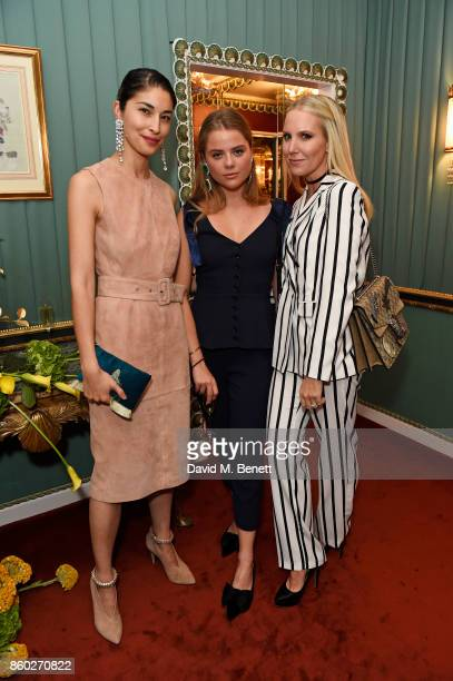 Caroline Issa Bea Fresson and Alice NaylorLeyland attend the William Vintage x Farfetch Gianni Versace archive launch dinner at The Dorchester on...