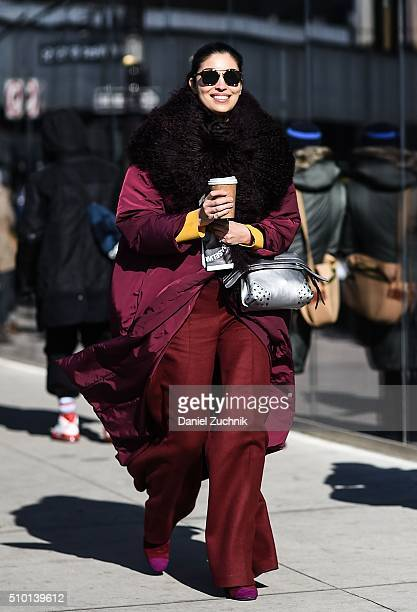 Caroline Issa is seen outside the Tibi show wearing a red jacket red pants and a black scarf during New York Fashion Week Women's Fall/Winter 2016 on...
