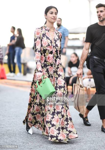 Caroline Issa is seen wearing a floral dress and green bag outside the Jason Wu show during New York Fashion Week S/S20 on September 08 2019 in New...