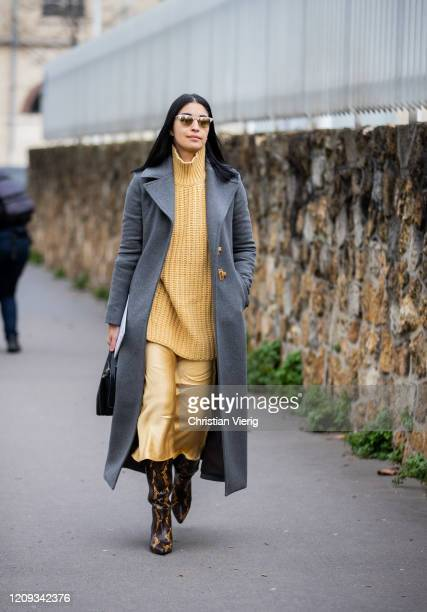 Caroline Issa is seen wearing camel turtleneck and silk skirt, grey wool coat outside Loewe during Paris Fashion Week - Womenswear Fall/Winter...