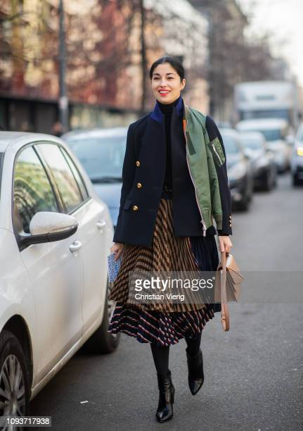 Caroline Issa is seen wearing two tone asymmetric jacket striped skirt outside Sunnei during Milan Menswear Fashion Week Autumn/Winter 2019/20 on...