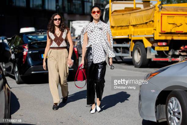 Caroline Issa is seen wearing white top with dots print, black vinyl pants outside Preen during London Fashion Week September 2019 on September 15,...