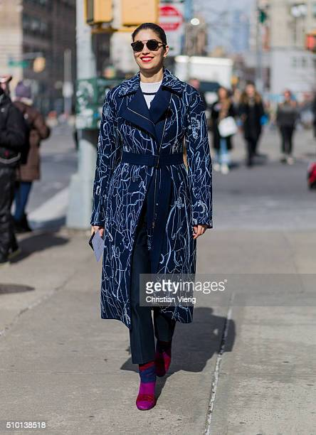 Caroline Issa is wearing a long blue wool coat with floral print and purple shoes seen outside Jason Wu during New York Fashion Week Women's...