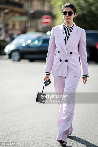 Caroline Issa is wearing a pink suit outside the Dries Van Noten show during Paris Fashion Week Spring Summer 2017 on September 28 2016 in Paris...