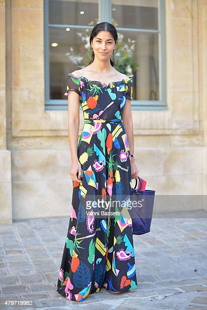 Caroline Issa poses wearing an Isolda dress before the Schiapparelli show at Place Vendome on July 6 2015 in Paris France