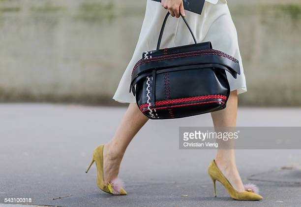 Caroline Issa wearing a black red Tods bag outside Balmain during the Paris Fashion Week Menswear Spring/Summer 2017 on June 25 2016 in Paris France