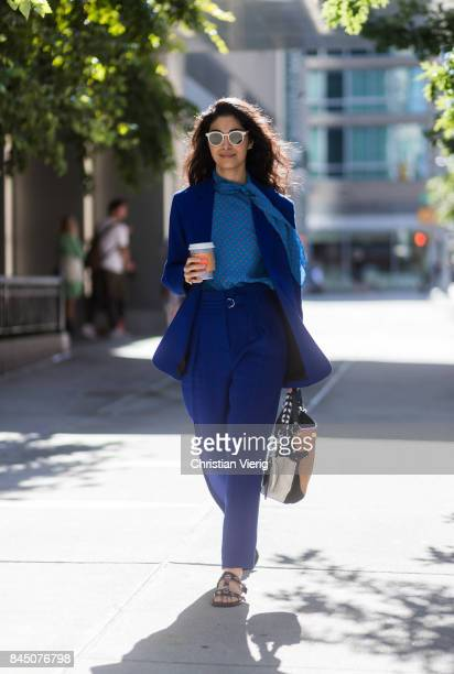Caroline Issa wearing a blue suit sandals seen in the streets of Manhattan outside SelfPortrait during New York Fashion Week on September 9 2017 in...