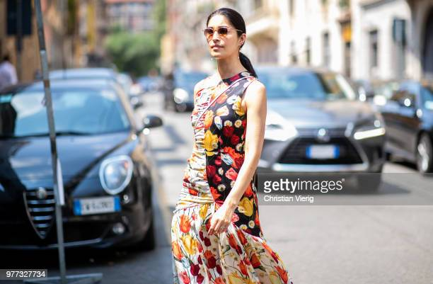Caroline Issa wearing a dress with floral print is seen outside Santoni during Milan Men's Fashion Week Spring/Summer 2019 on June 17 2018 in Milan...
