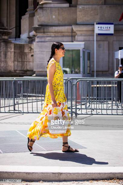 Caroline Issa wearing a floral print dress white bag and black sandals is seen outside Chanel show during Paris Fashion Week Haute Couture...