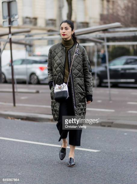 Caroline Issa wearing a green puffy jacket Chanel bag outside Ellery on March 7 2017 in Paris France