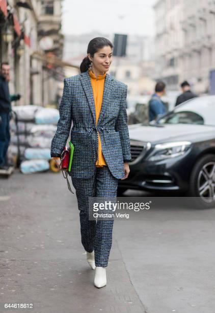 Caroline Issa wearing a grey suit outside Emilio Pucci during Milan Fashion Week Fall/Winter 2017/18 on February 23 2017 in Milan Italy