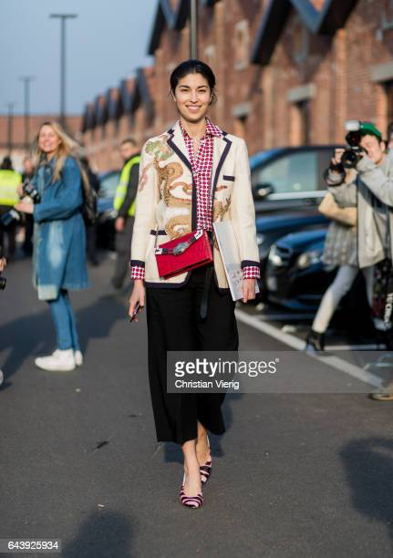 Caroline Issa wearing a Gucci blazer black cropped pants checked button shirtoutside Gucci on February 22 2017 in Milan Italy