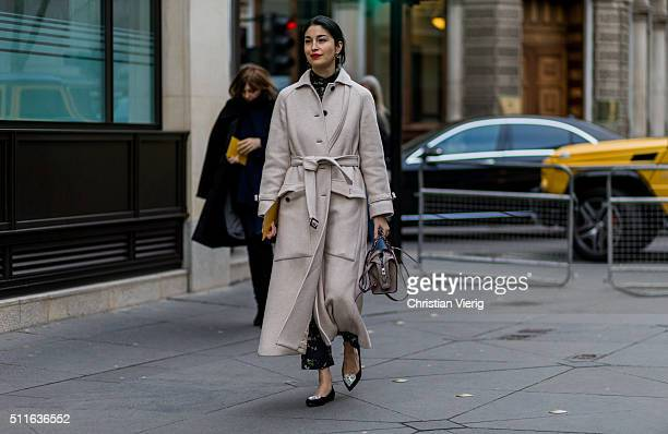 Caroline Issa wearing a long creme wool coat seen outside Mulberry during London Fashion Week Autumn/Winter 2016/17 on February 21 2016 in London...