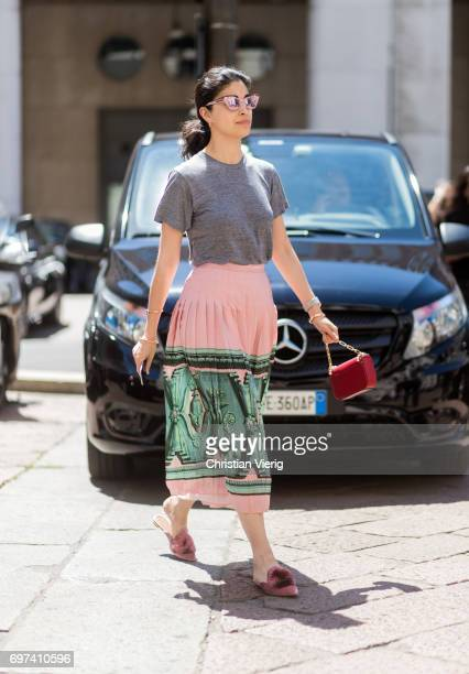 Caroline Issa wearing a midi skirt grey tshirt is seen outside Salvatore Ferragamo during Milan Men's Fashion Week Spring/Summer 2018 on June 18 2017...