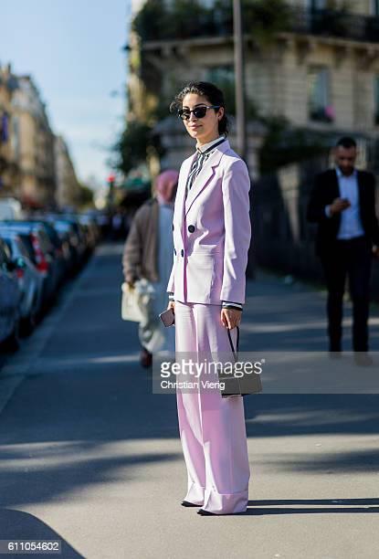 Caroline Issa wearing a pink suit outside Dries van Noten on September 28 2016 in Paris France