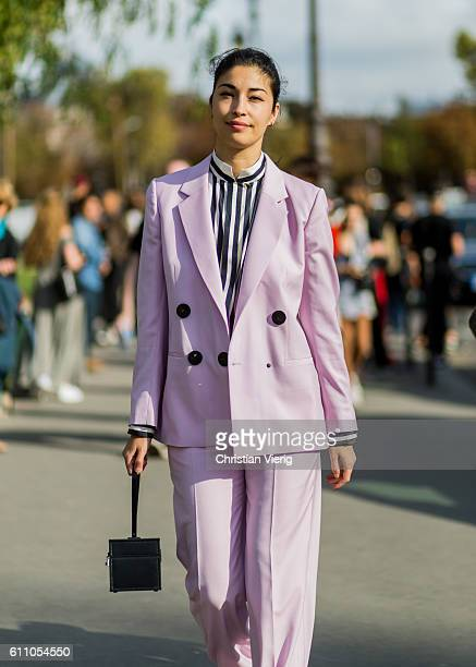 Caroline Issa wearing a pink suit outside Maison Margiela on September 28 2016 in Paris France
