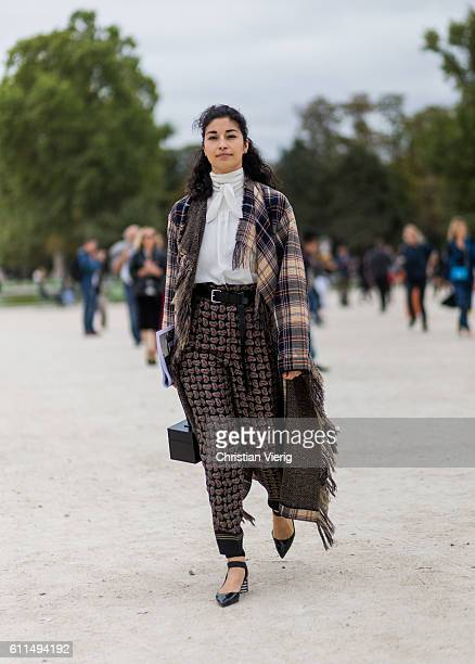 Caroline Issa wearing a plaid poncho outside Carven on September 29 2016 in Paris France