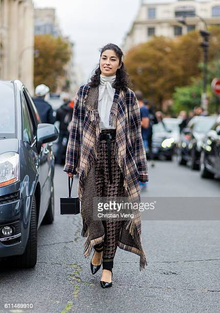Caroline Issa wearing a plaid poncho outside Chloe on September 29 2016 in Paris France