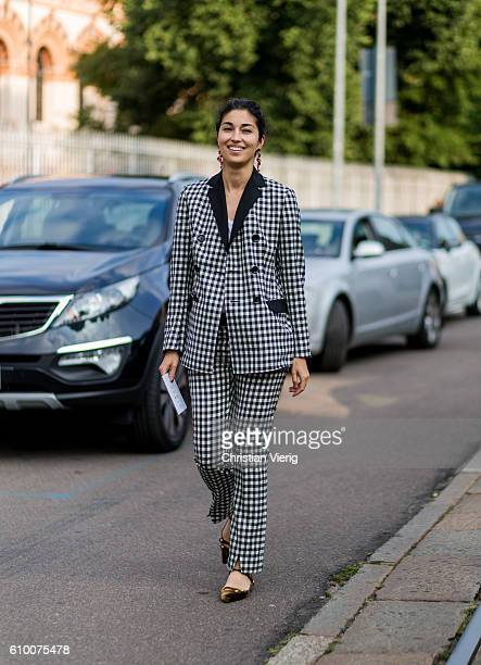 Caroline Issa wearing a plaid suit outside Tods during Milan Fashion Week Spring/Summer 2017 on September 23 2016 in Milan Italy
