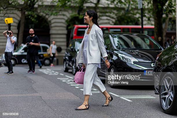 Caroline Issa wearing a white suit and laced flats outside Nasir Mazhar during The London Collections Men SS17 on June 11 2016 in London England
