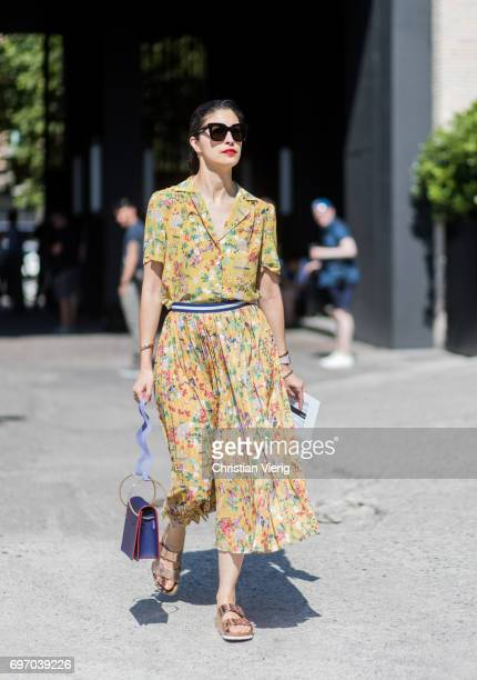 Caroline Issa wearing a yellow dress with floral print sandals is seen outside Neil Barrett during Milan Men's Fashion Week Spring/Summer 2018 on...