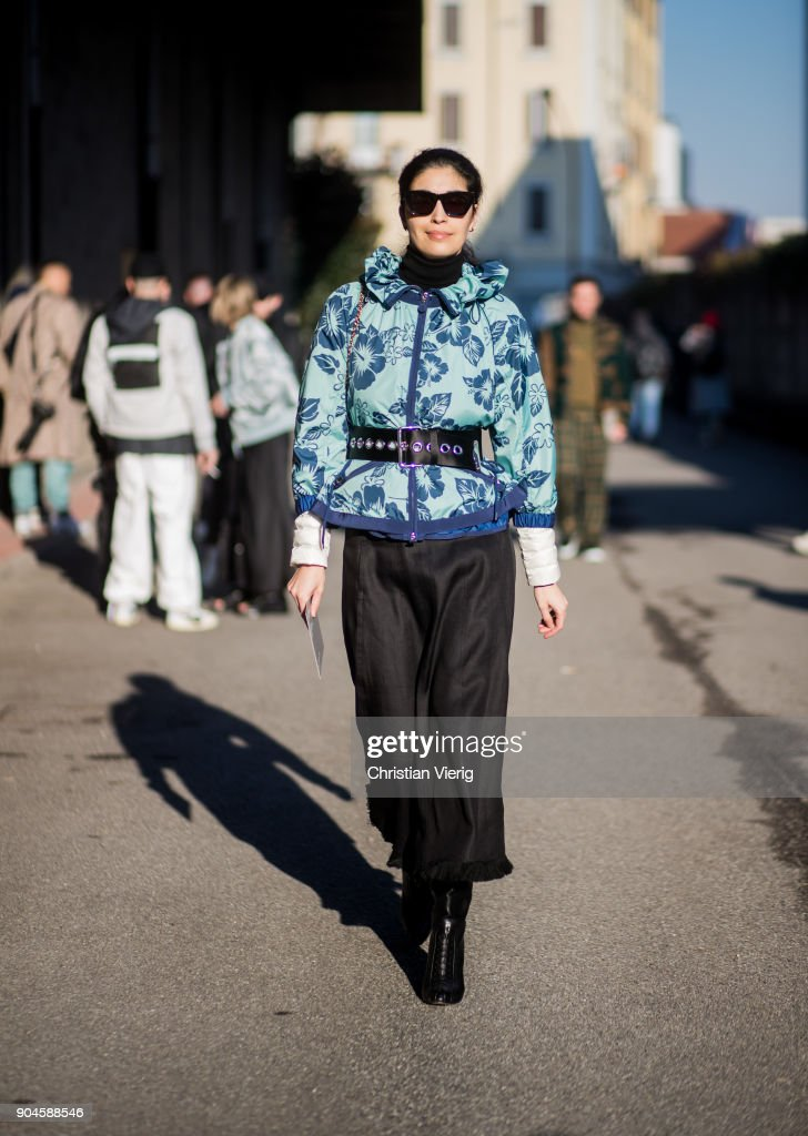 Caroline Issa wearing belted jacket , black cropped pants is seen outside Diesel during Milan Men's Fashion Week Fall/Winter 2018/19 on January 13, 2018 in Milan, Italy.
