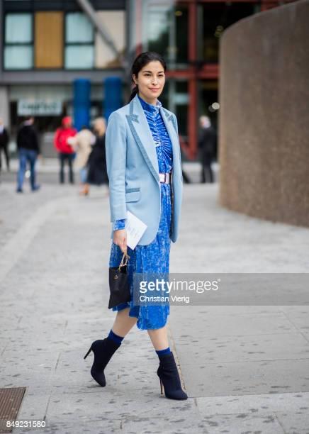 Caroline Issa wearing blue dress outside Christopher Kane during London Fashion Week September 2017 on September 18 2017 in London England