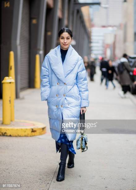 Caroline Issa wearing blue puffer coat seen outside Ralph Lauren on February 12 2018 in New York City