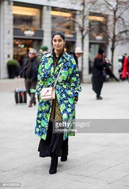 Caroline Issa wearing coat with floral coat is seen outside MSGM during Milan Fashion Week Fall/Winter 2018/19 on February 25 2018 in Milan Italy